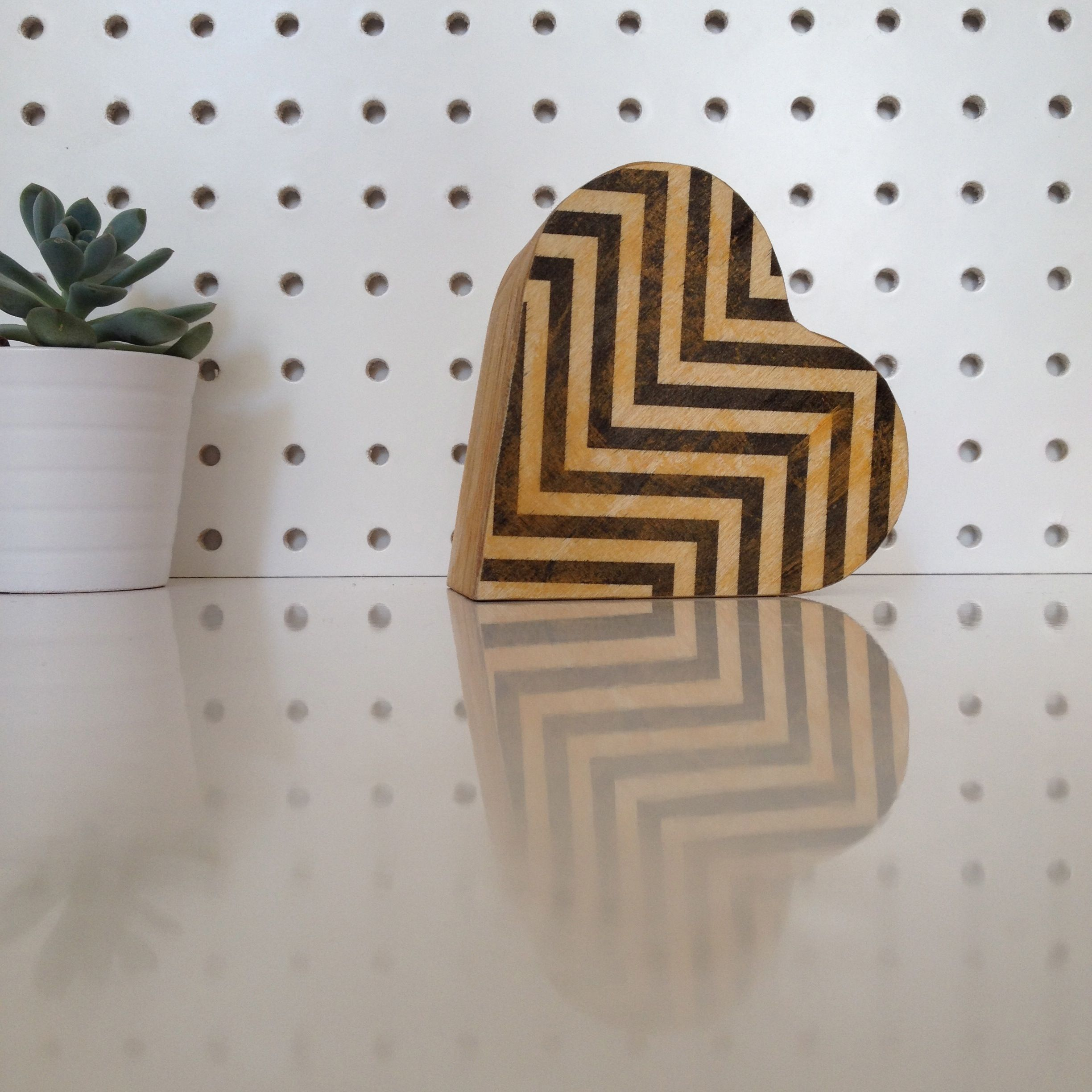 A Cute Heart Shaped Wooden Trinket Box With A Chevron