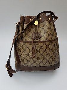 ddf752a14ac91b GUCCI Bag. Gucci GG Vintage Monogram Beige / Brown Shoulder Bucket  Drawstring Bag. Italian designer purse.
