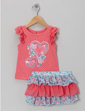 I saw this at Nannette's girls sets at Zulily. What I like is the applique. Something like that you can easily use to make any top special.