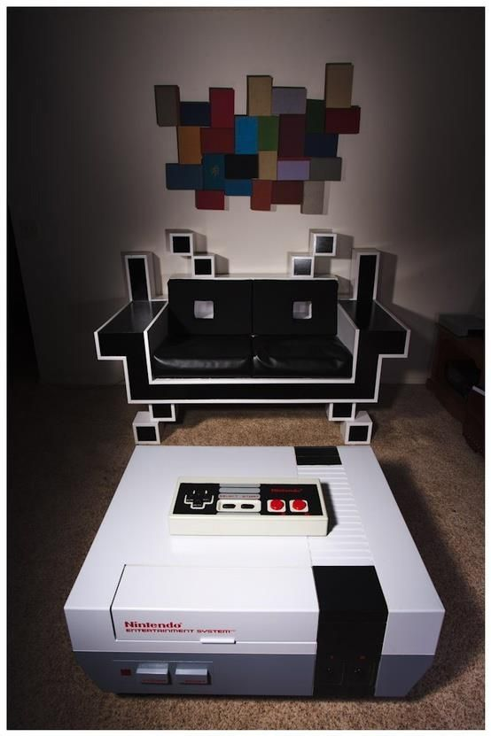 NES Coffee Table and Space Invaders Couch. So Awesome. The oversized NES  controller is fully functional. And the controller port is an extra power  supply.