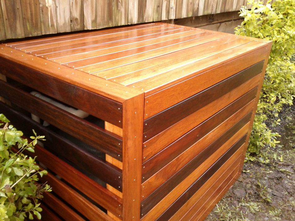 wood planks box for pool equipment storage with large air