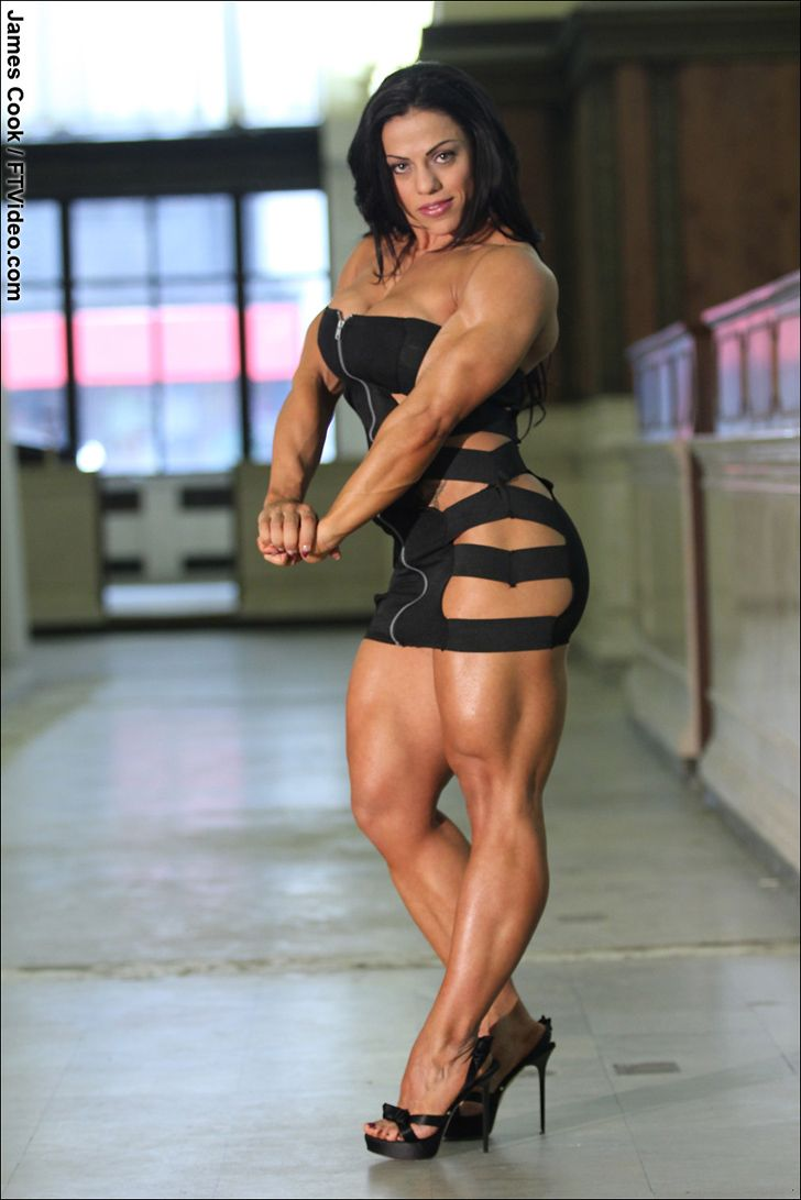 Female Bodybuilder Mavi Gioia flexing her lovely muscles