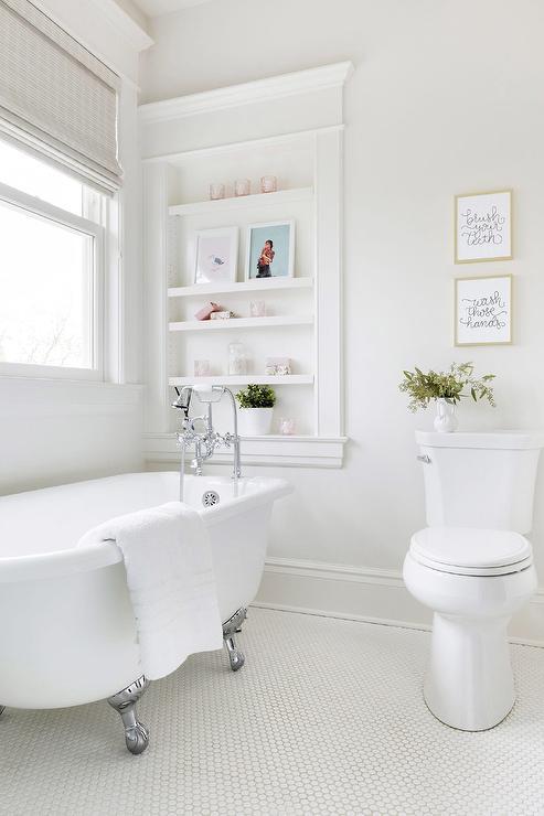 Silver Claw Floor Bathtub on White Penny Tiles ...