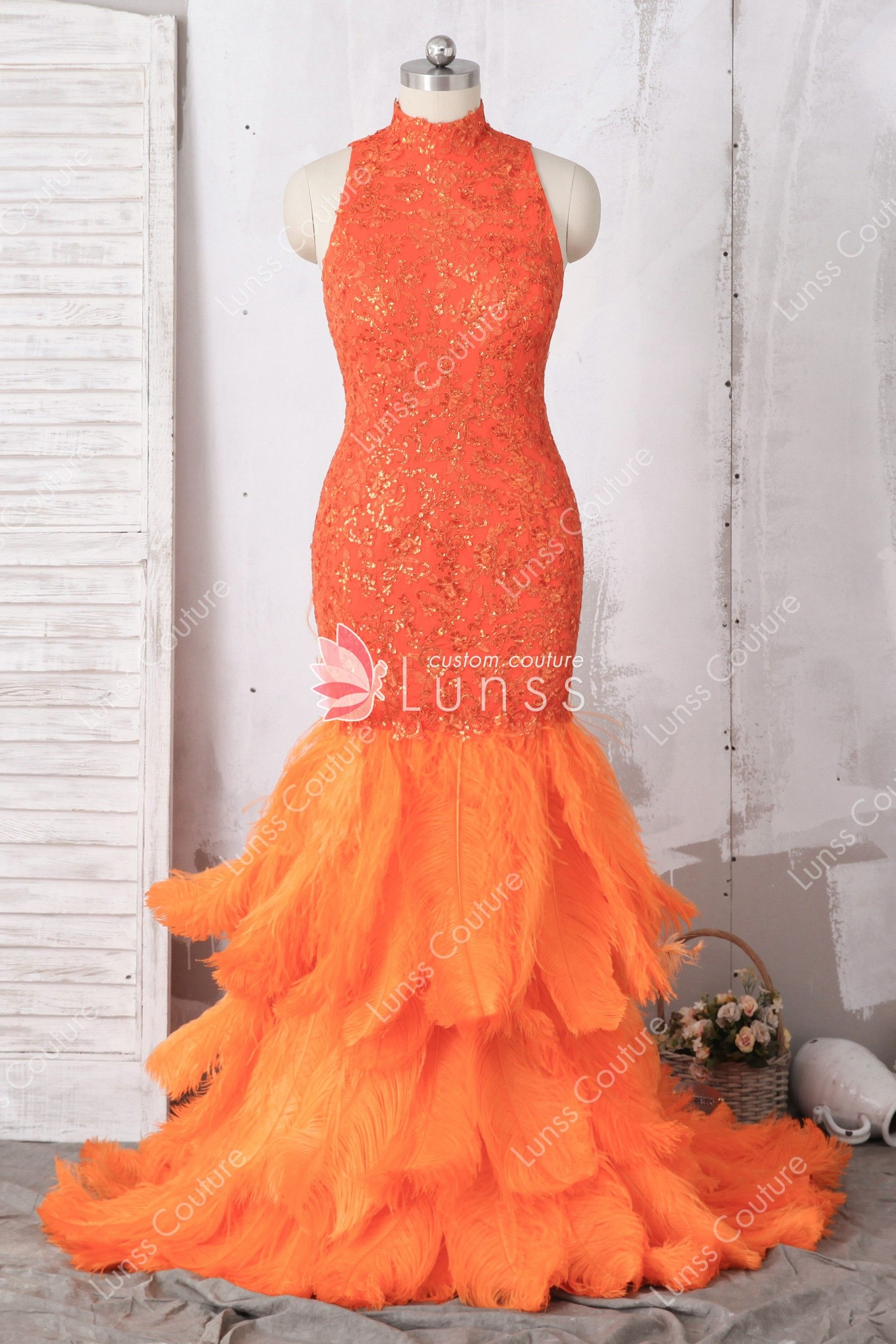 e58f2e311b3bc7 This luxury orange trumpet prom dress features high neckline and cut-out at  the back