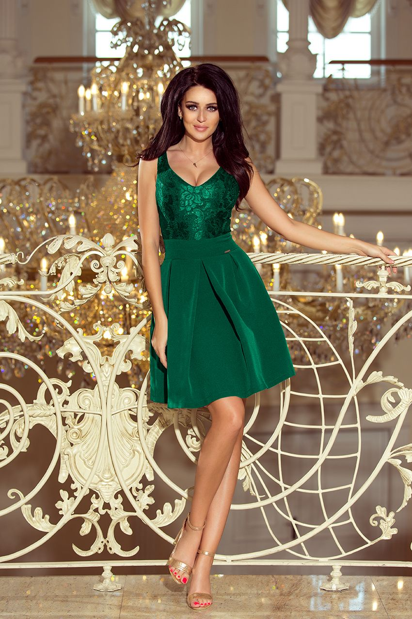 670a27cc05 Śliczna zielona sukienka z kieszonkami i koronkowym dekoltem. Producent  sukienek numoco. Beautiful green dress with pockets and lace neckline.