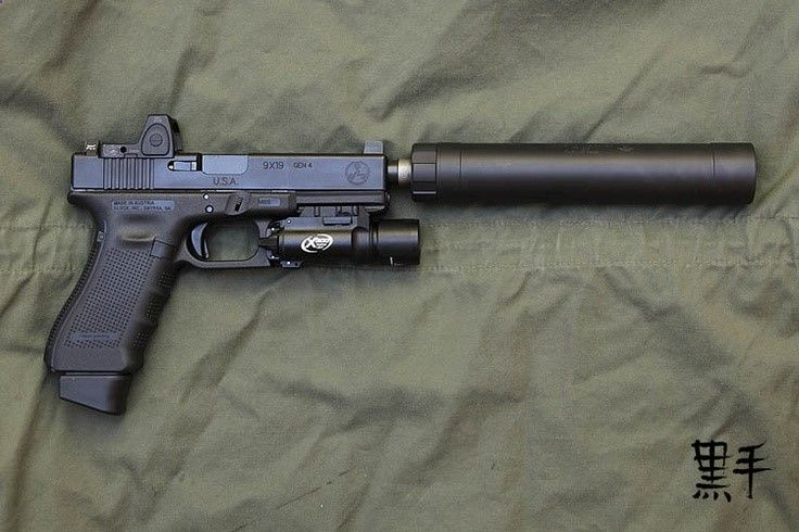Glock 17 Gen 4 with extended magazine, weapon light, suppressor and
