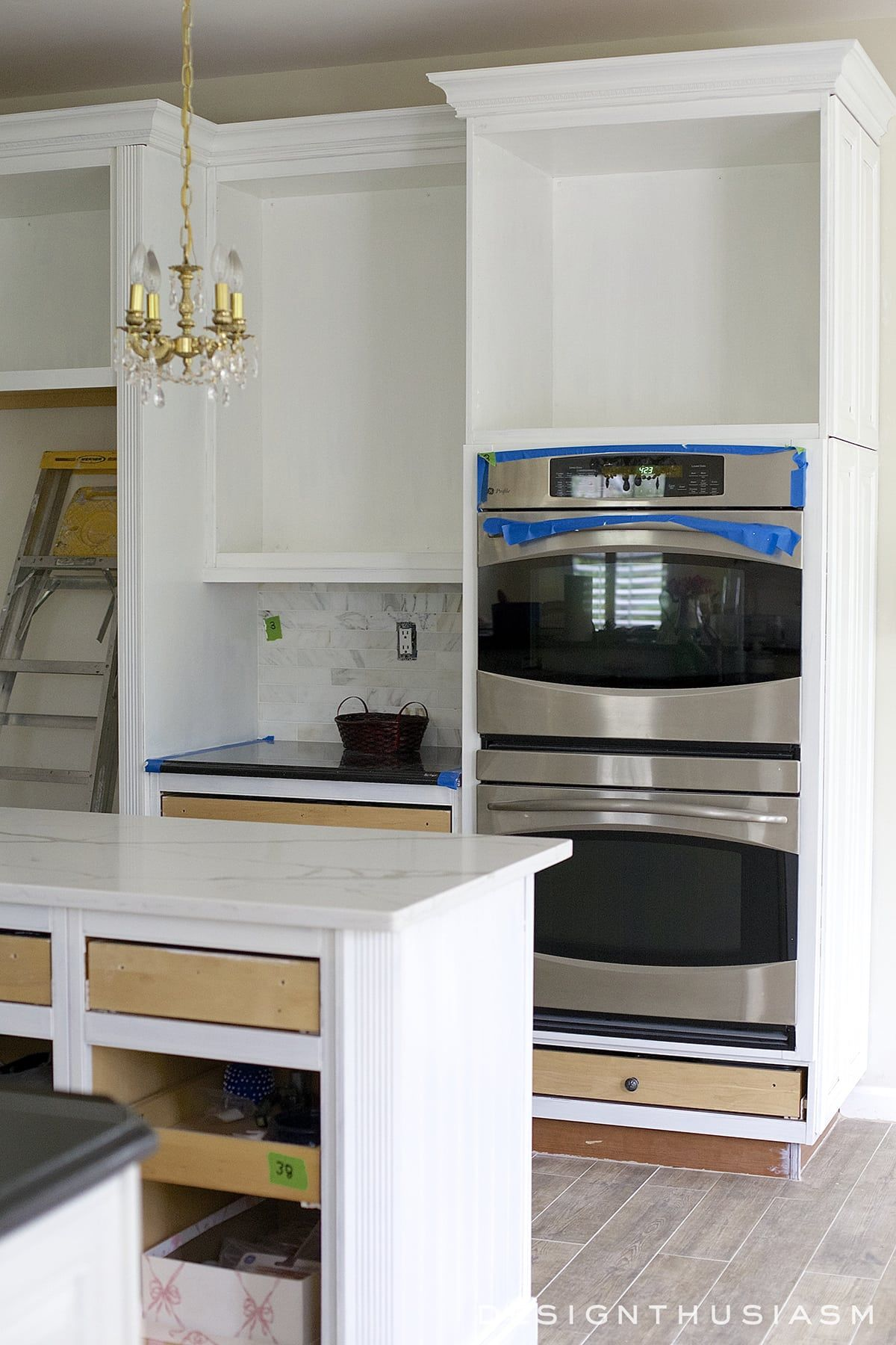 White Painted Cabinets Simplify a Kitchen Renovation ...