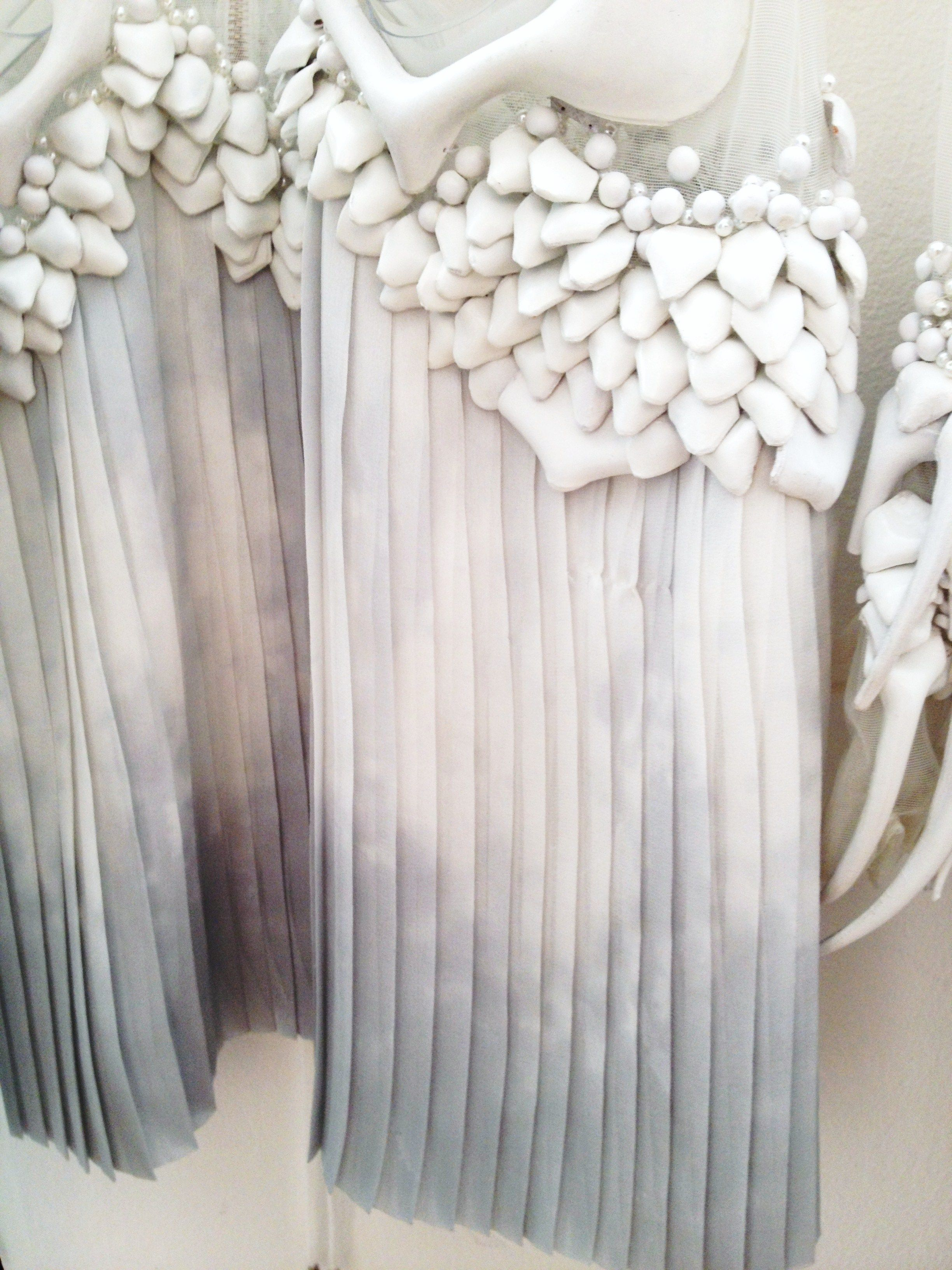 Dress detail with pale print, pleats & textured embellishment; textiles for fashion // Anne Sofie Madsen