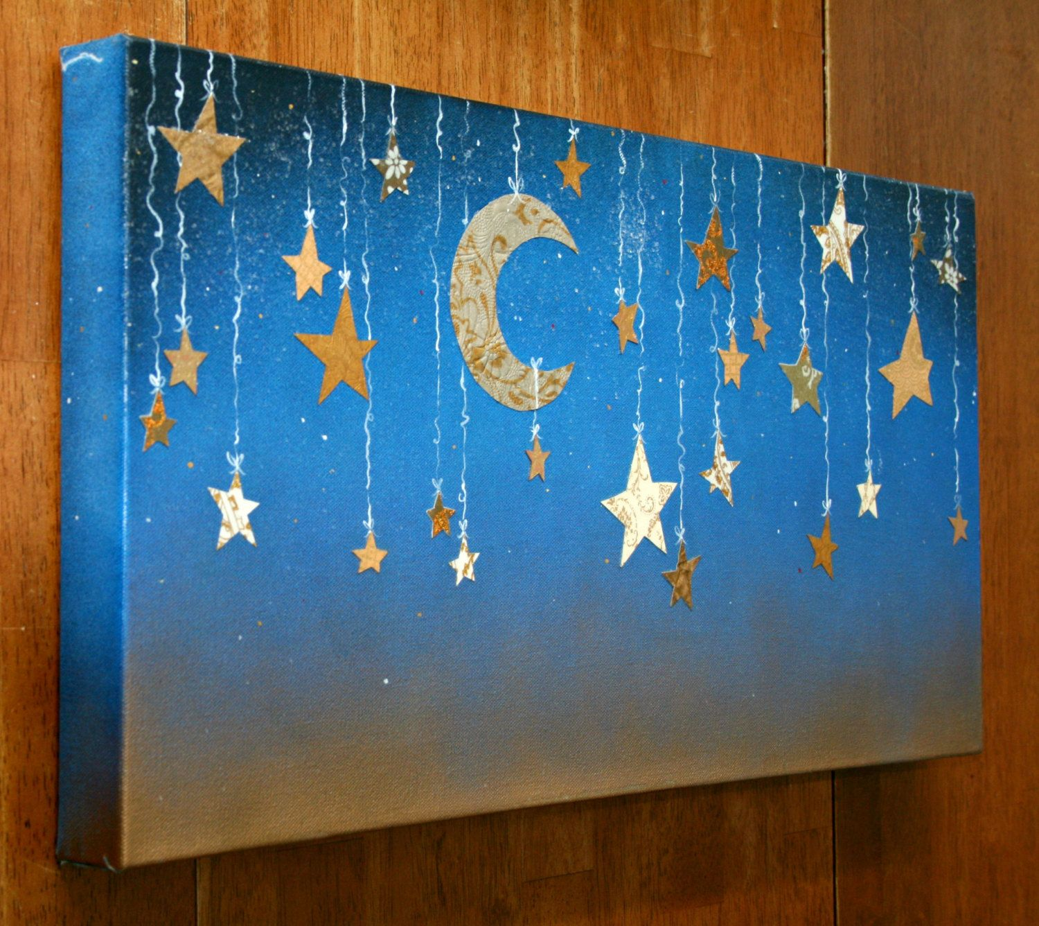 Starry night with hanging moon and stars in cut designer paper and