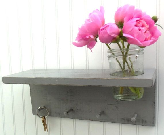 like the combo of fresh flowers with a practical key holder. maybe by the back door