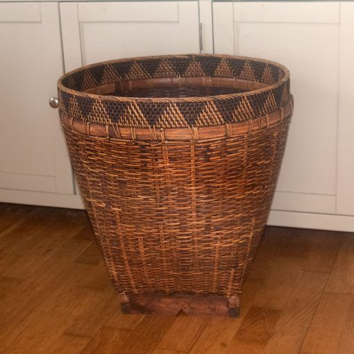 Beautiful Large Round Laundry Or Storage Basket Made From Bamboo With An Attractive  Triangular Design Around The Top And A Square Wooden Base.