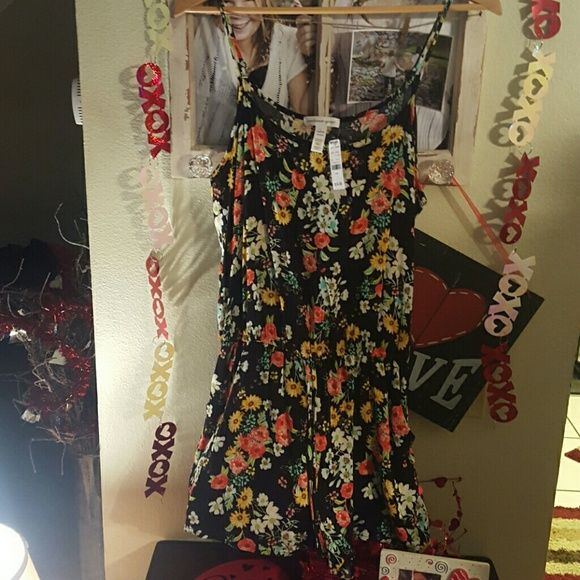 One piece short outfit Black with colorful flower print. One piece outfit has tie around waist. Very flowy and comfortable. ambience apparel Shorts