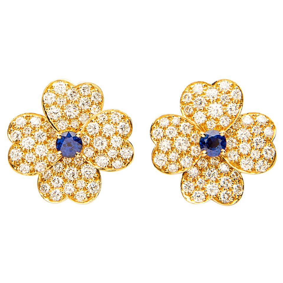 Van Cleef & Arpels Sapphire Diamond Gold Cosmos Earrings | From a unique collection of vintage clip-on earrings at https://www.1stdibs.com/jewelry/earrings/clip-on-earrings/