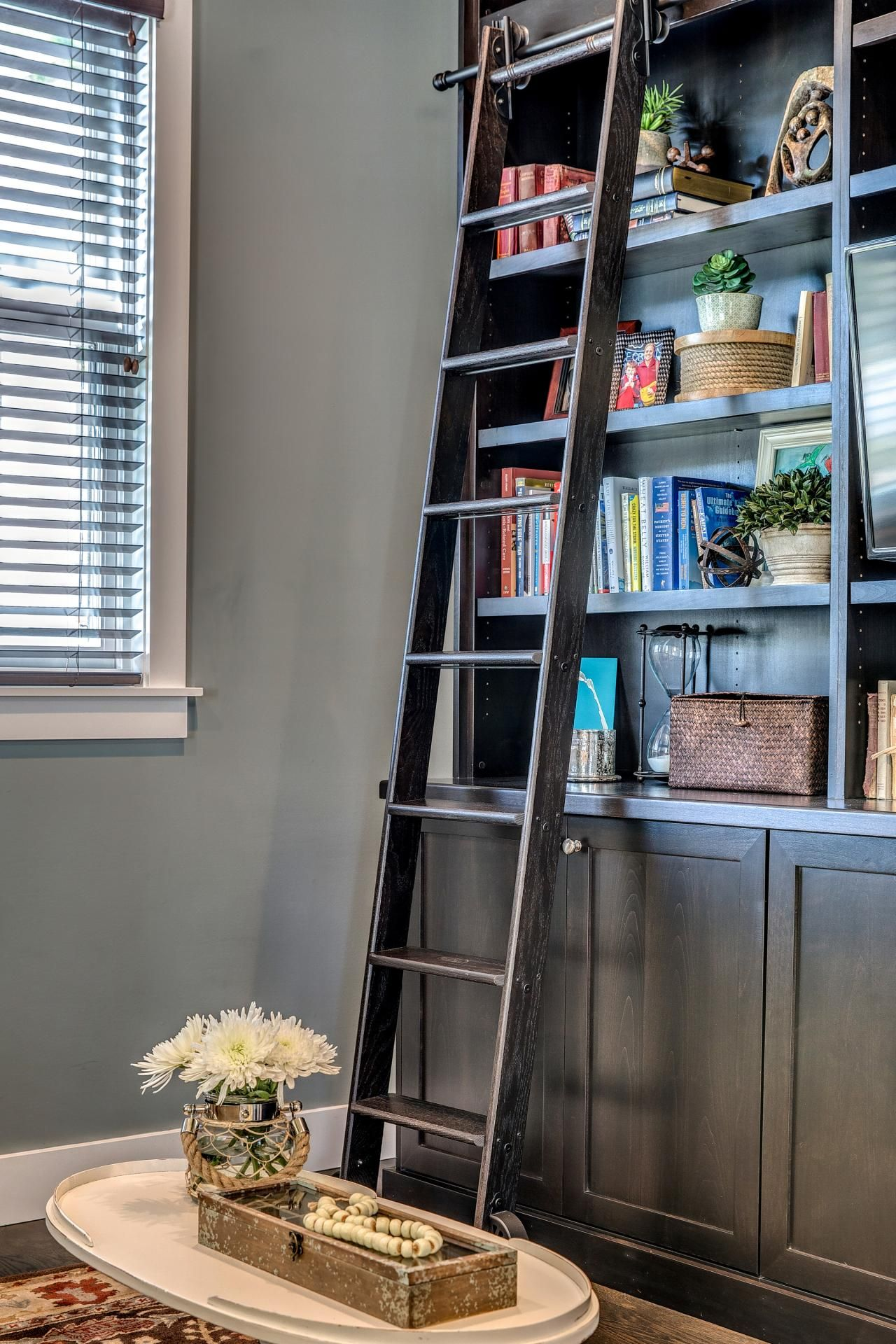 decorative living room bookshelf with sliding ladder ideas