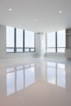 Modern sleek minimal, white polished concrete floors in apartments!