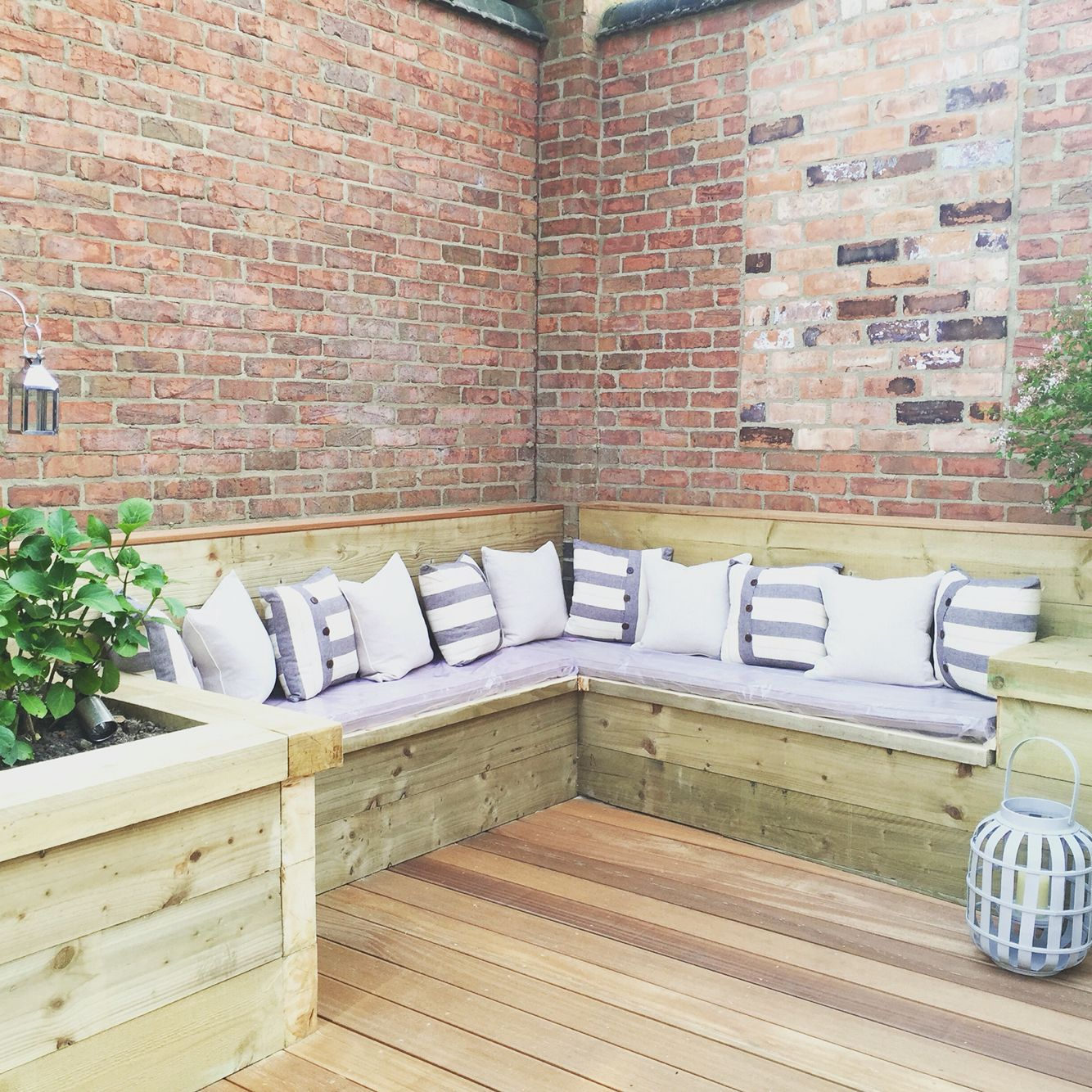 Garden Built In Corner Seating Area. Sleepers And Decking
