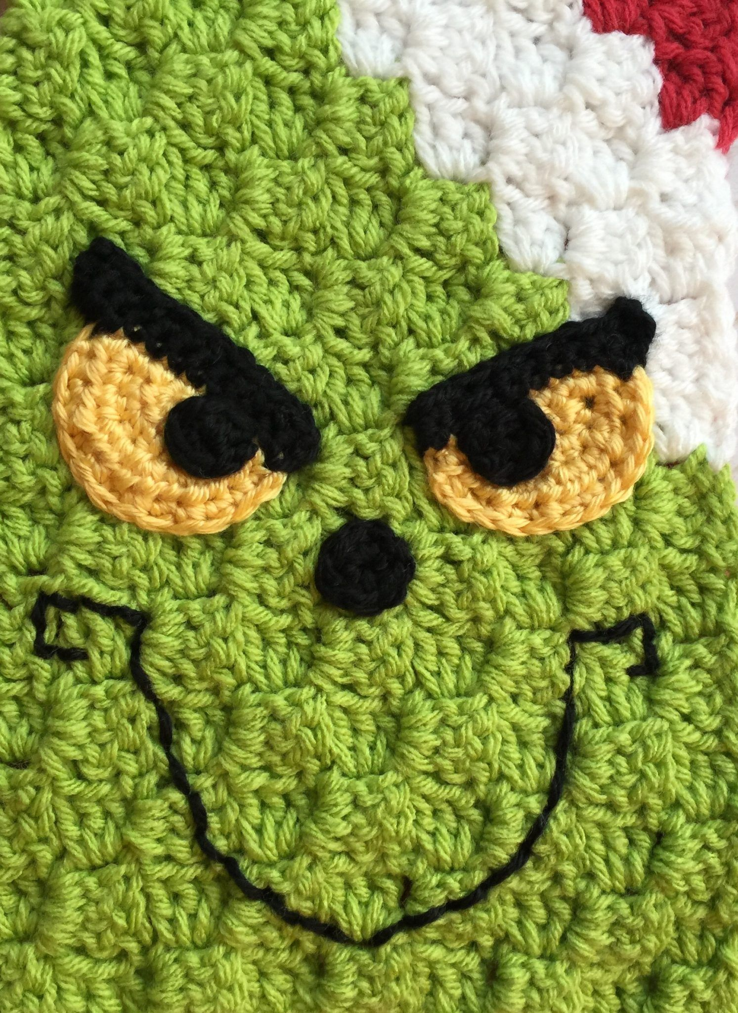 80c76020354 This Grinch Inspired corner-to-corner scarf is amazing! Embellish with  yellow eyes