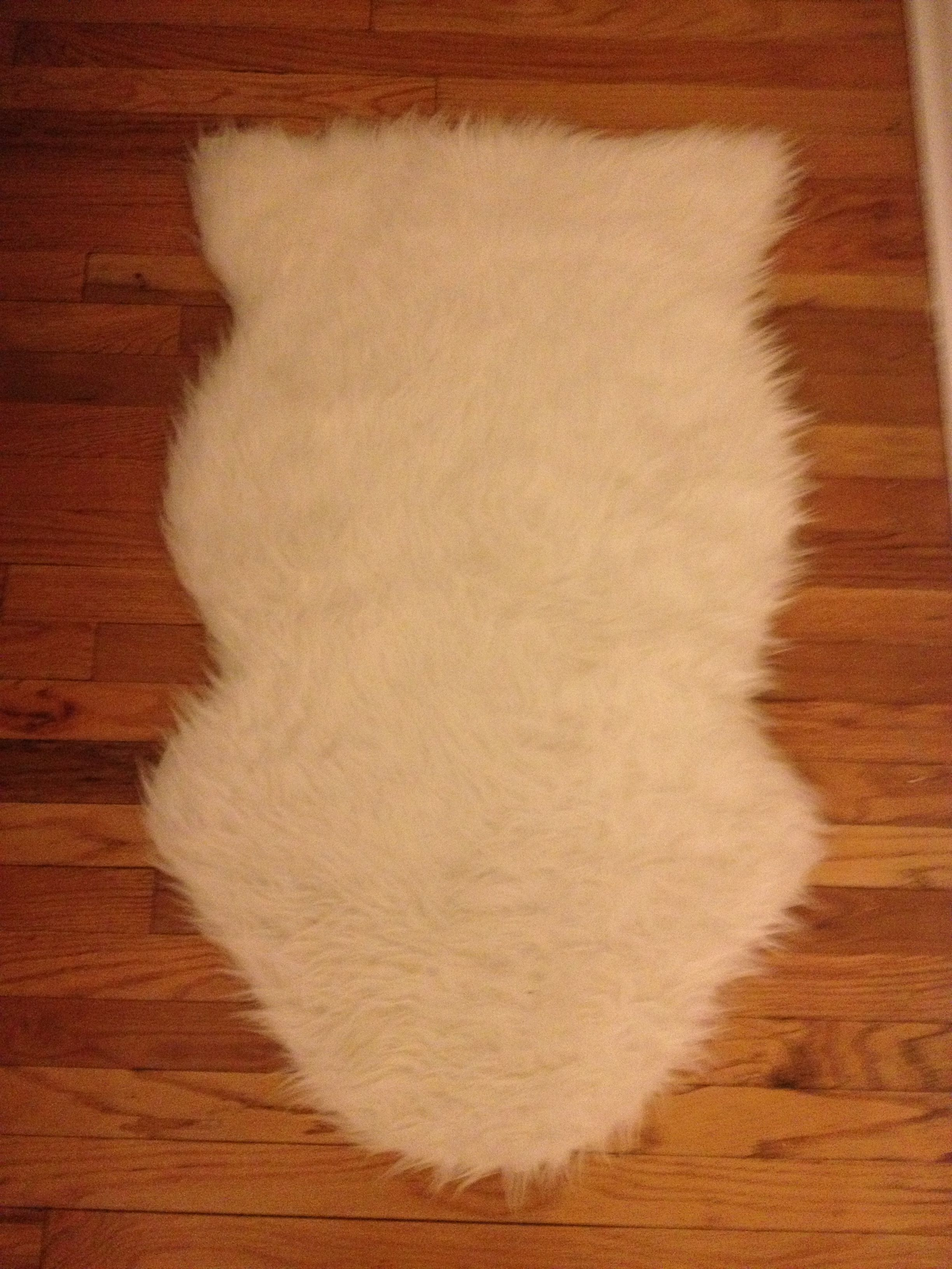 White Faux Sheepskin Rug Plus Wooden Floor For Decoration Ideas