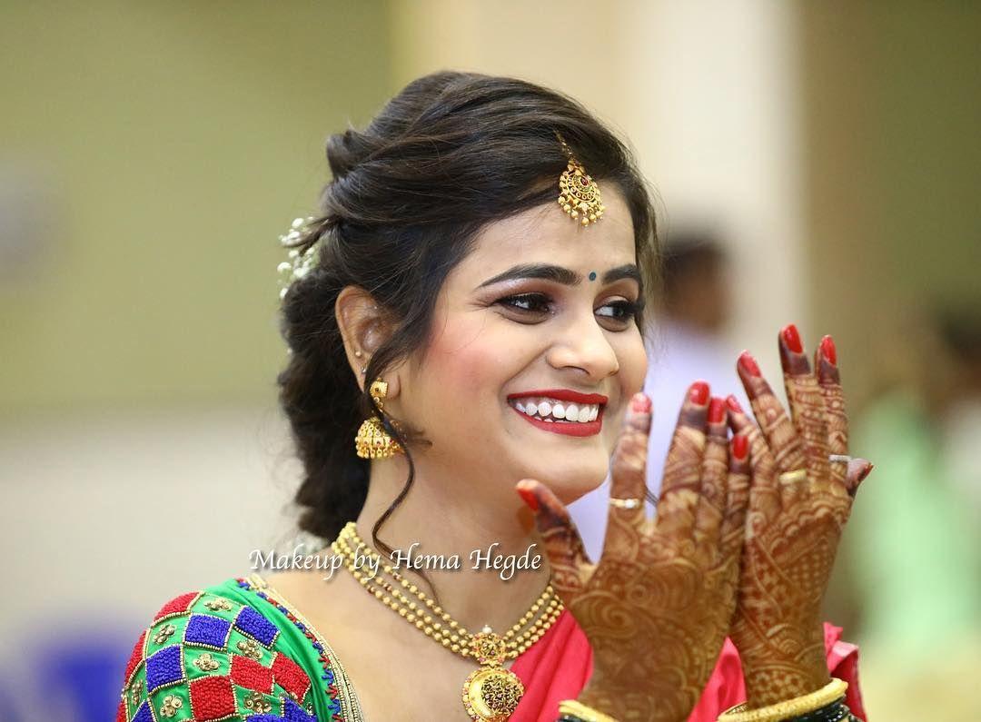 south indian bride. bridal hairstyle. pink lips. saree