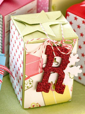 Decorate boxes with fun, festive embellishments and scrapbooking papers...