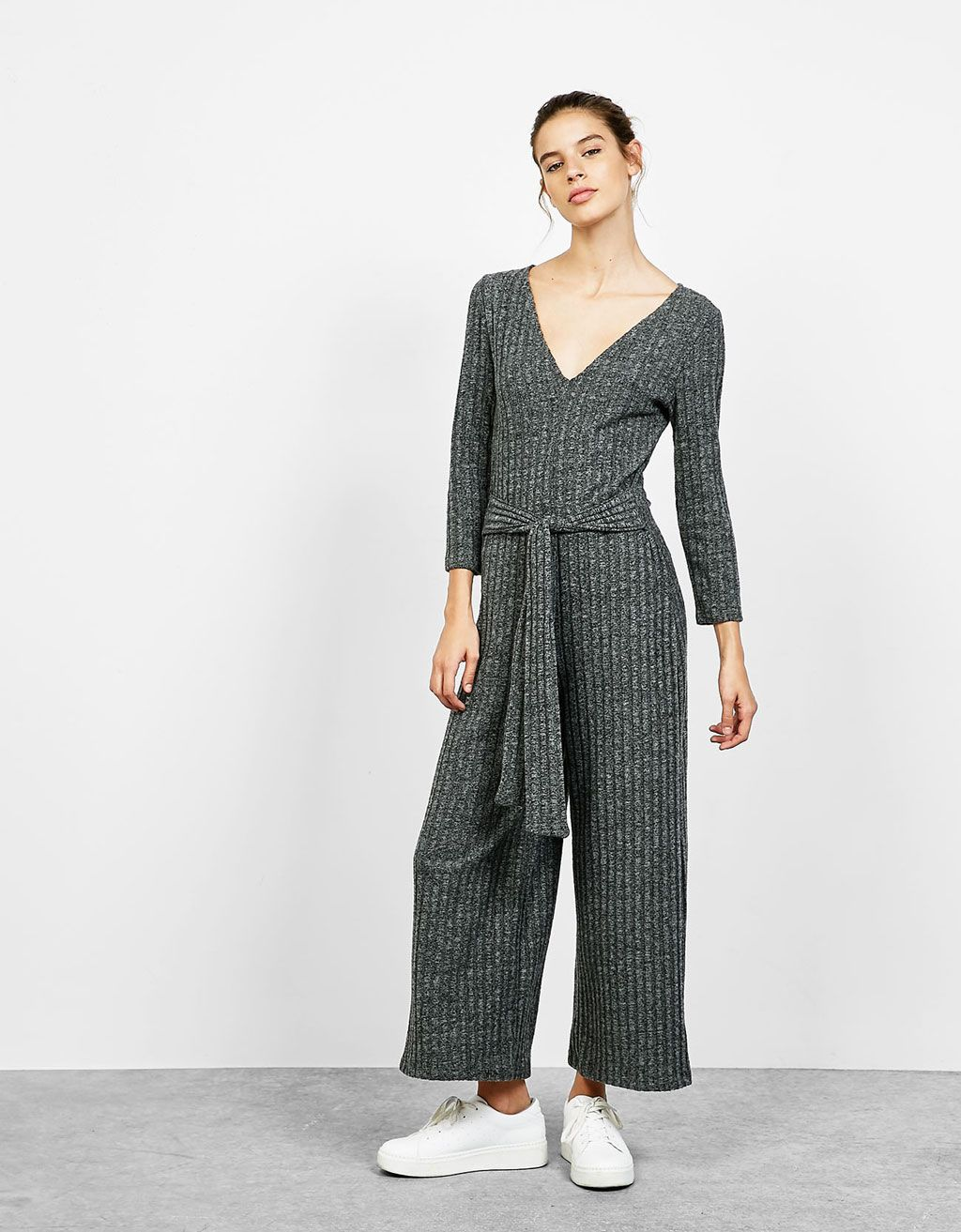 18bd5c9573 Ribbed jumpsuit with 3 4 sleeves with belt. Discover this and many more  items in Bershka with new products every week