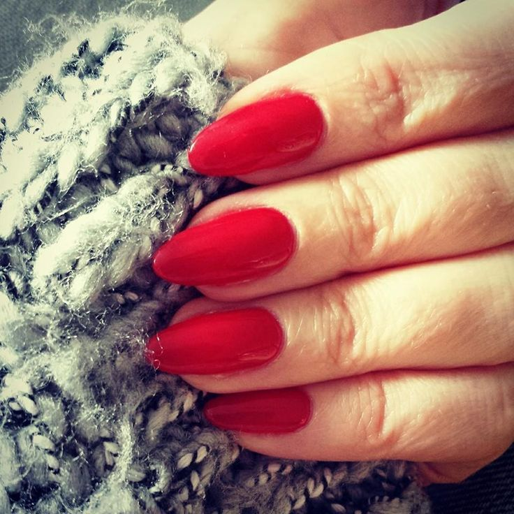Hot rod red Gelish on almond shaped natural nails. -