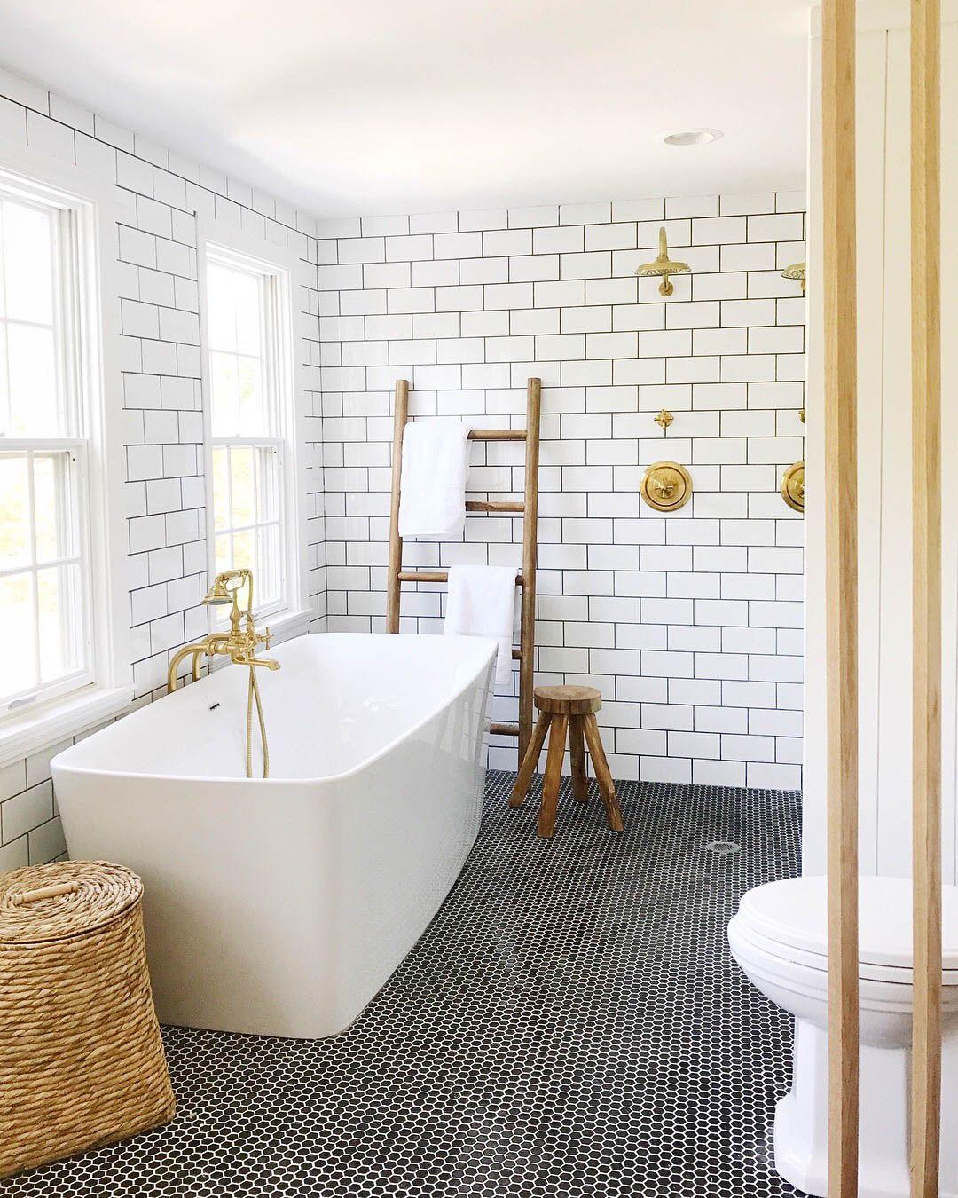 Black Penny Tile On The Floor White Freestanding Tub Brass Faucet Open Shower White Bathroom Tiles White Subway Tile Bathroom Bathroom Trends
