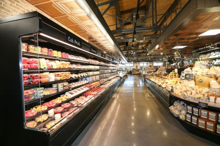 Exposed Steel Trusses Restored Wood Ceilings Rugged Brick And Polished Concrete Frame A Supermarket Design Interior Store Design Interior Supermarket Design