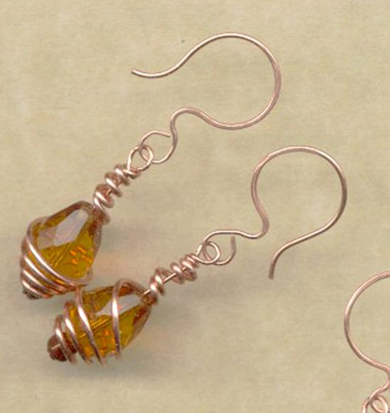 Large teardrop topaz crystals are ribboned with hammered copper wire and hung on  hand forged earwires. $20