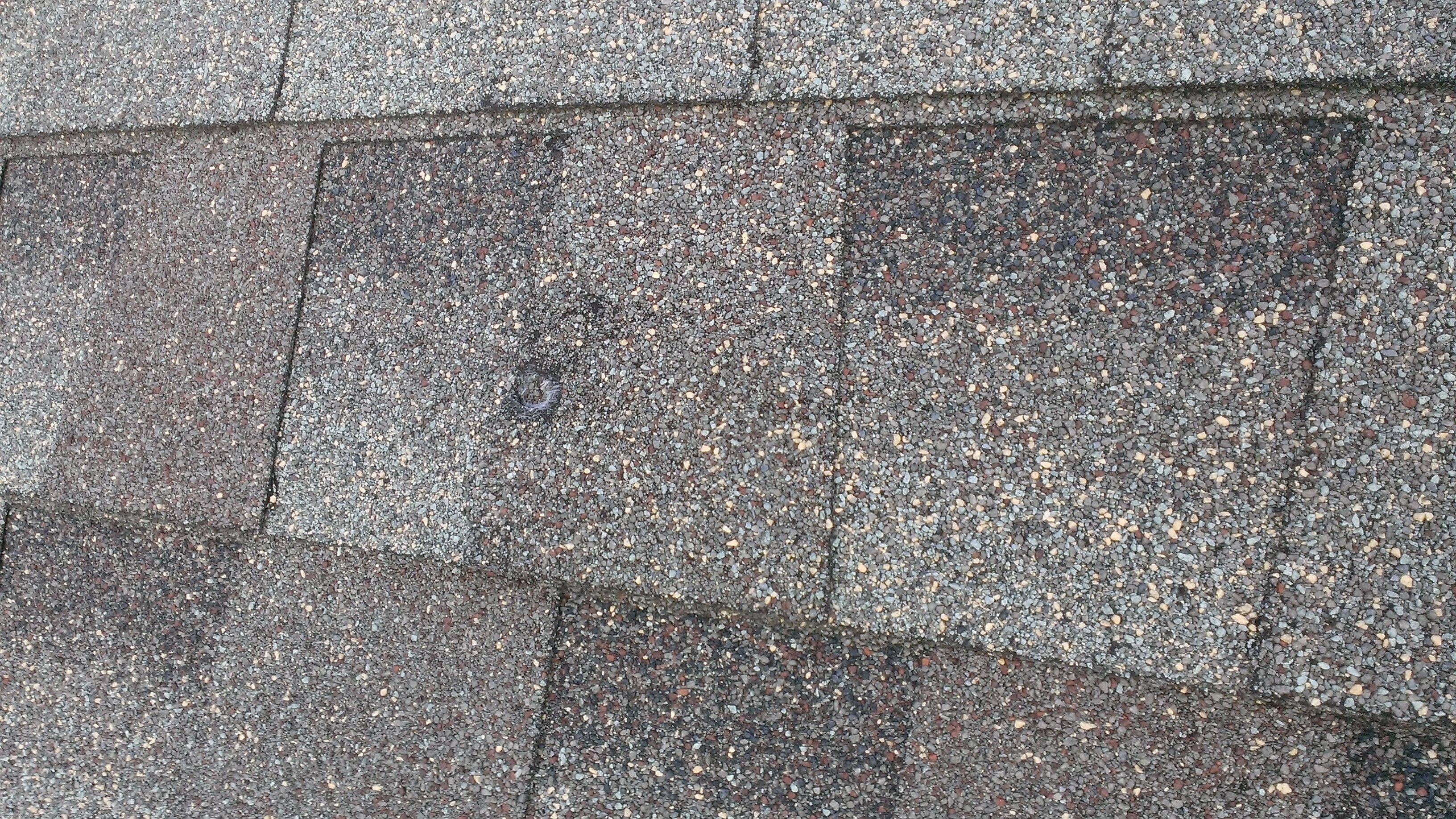 Roof Shingles Damaged By Hail You Can See This Hail Hit Quite Hard It Went Through Pretty Deep Into The Shingle Roof Shingles Roofing Roof