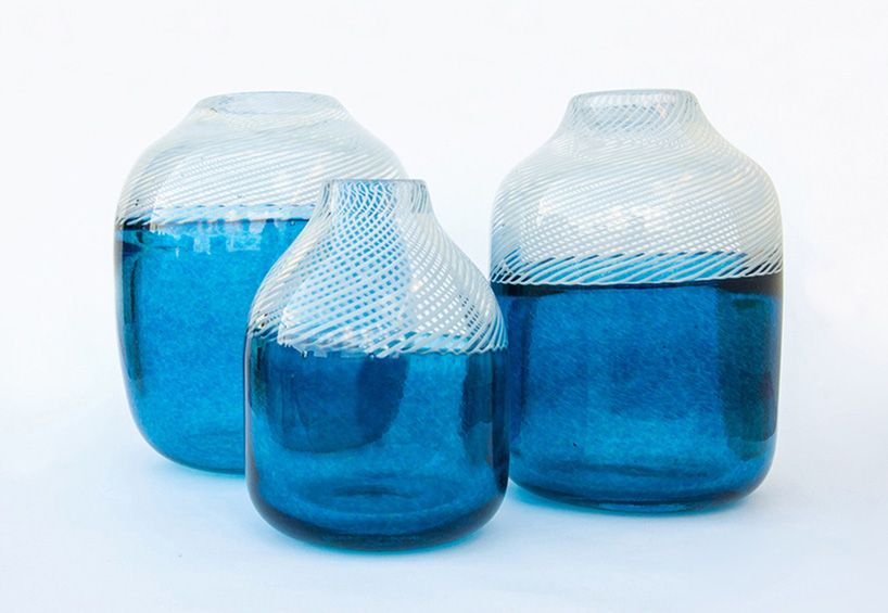 As an extension from the Moirai Lamps, idyllic summer collection is a reminiscence of the summer days spent by the Aegean coast and Greek Islands. Blue salt water, sand and ivory colored rocks inspires the color scheme of the three vases and two bowls. The glass technique is a combination of the Çeşm-i Bülbül technique …