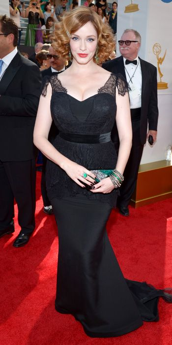 Christina Hendricks in a Christian Siriano gown with an Edie Parker clutch at the 65th Annual Primetime Emmy Awards, 2013