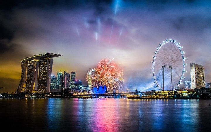 city singapore night new year fireworks sea light reflection hd