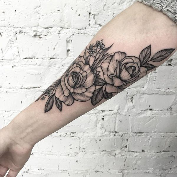 b7b17a5de Simple and beautiful floral sleeve tattoo. Even though it lacks bright and  sunny colors,