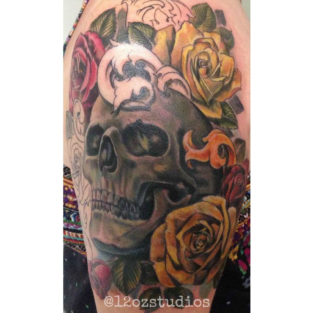Beautiful work in progress black and grey skull with pretty yellow and red roses female half sleeve tattoo by Alex Feliciano.