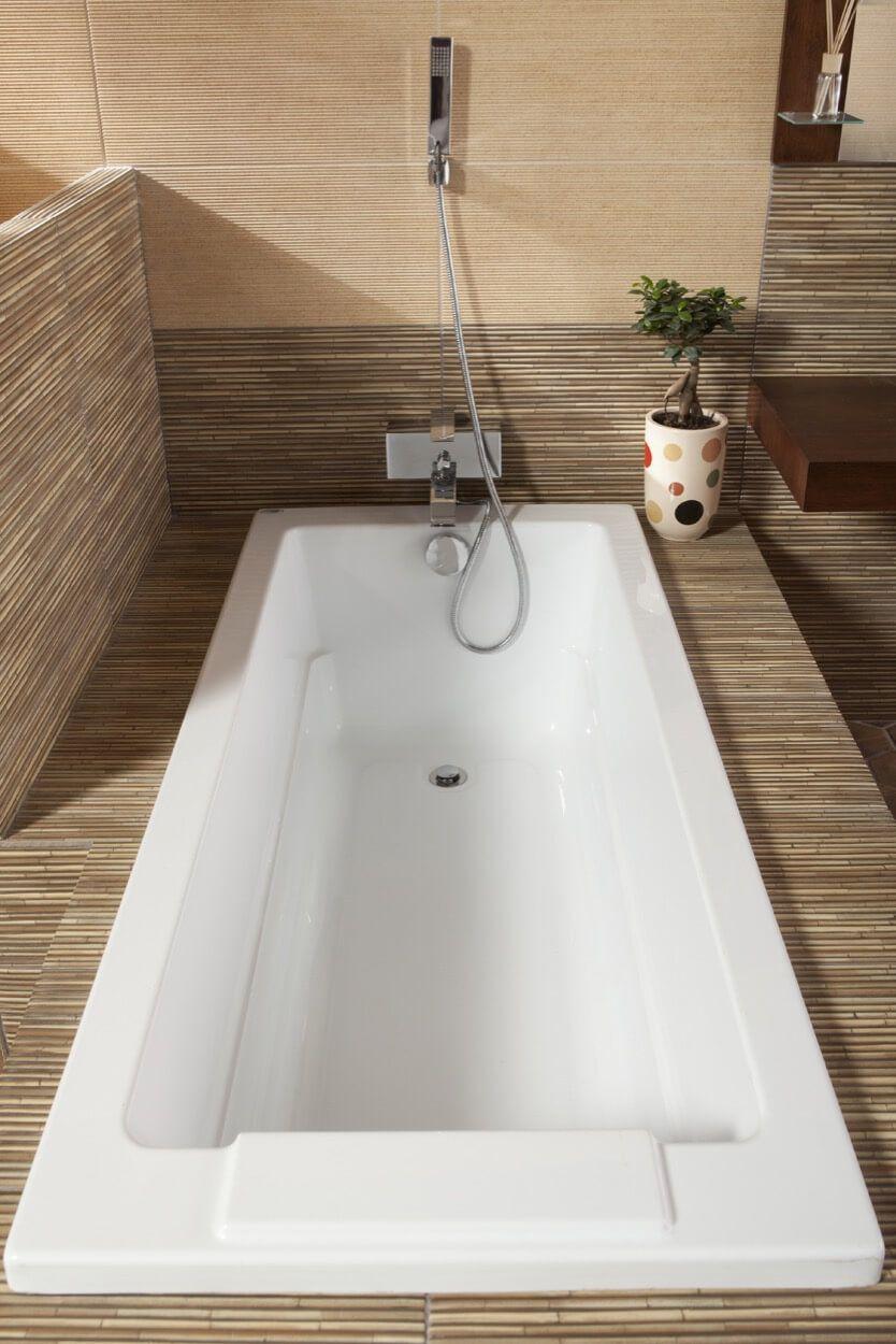 Encased Bathtub With Handheld Showerhead