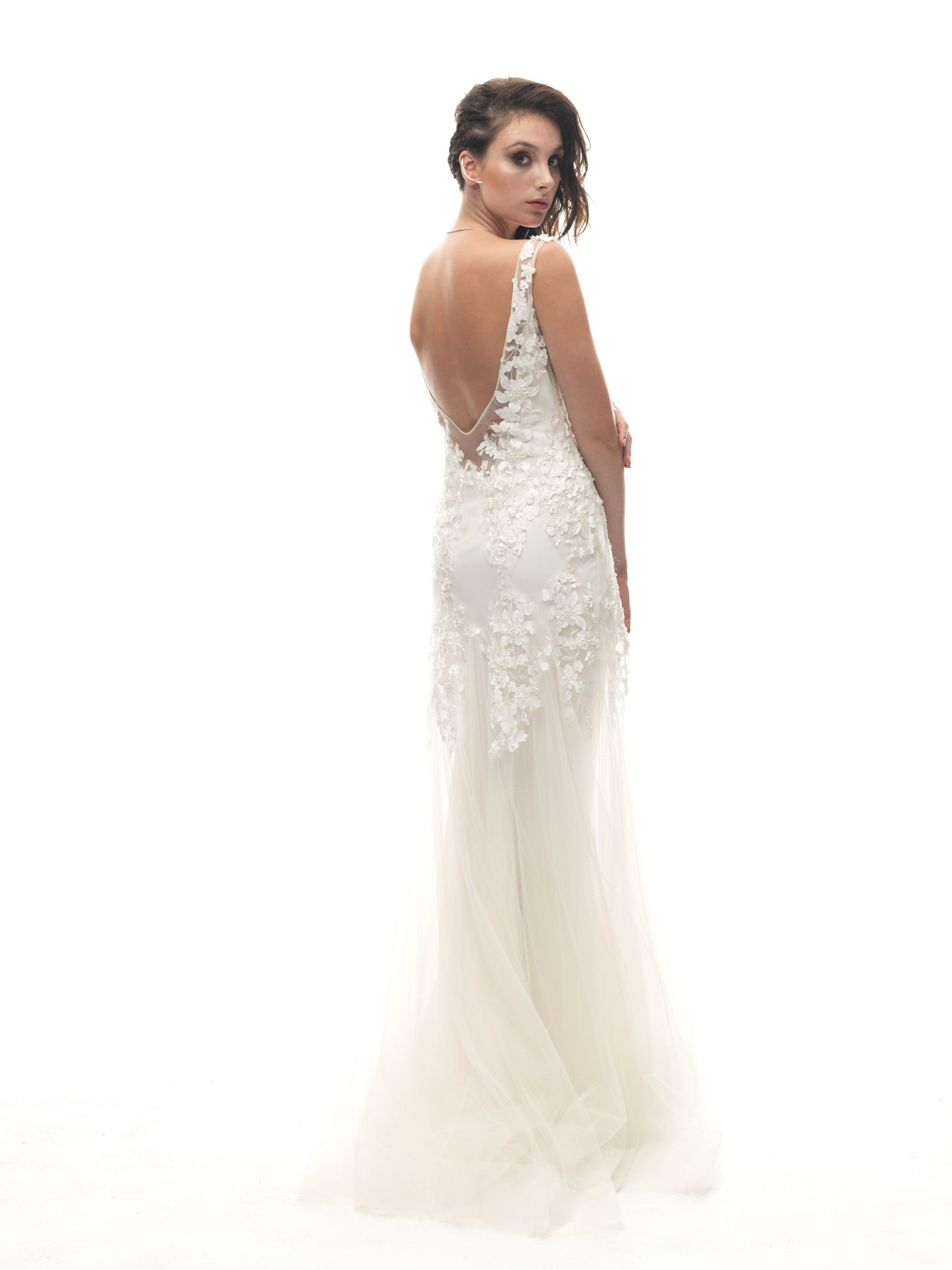 Wedding dress slip  A fitted V neck tulle gown with hand placed and beaded floral satin
