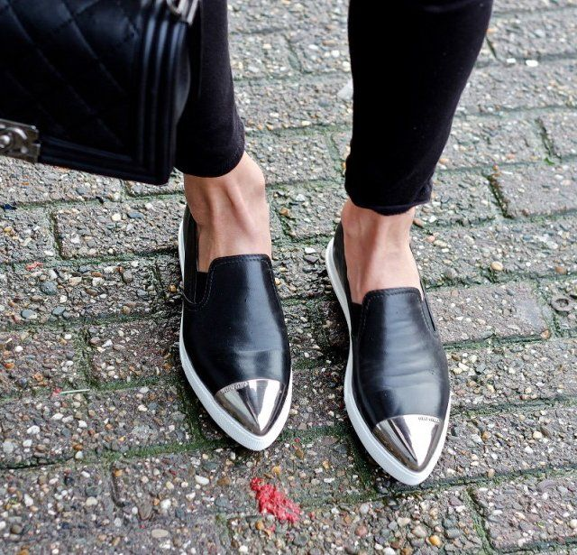 a6700c9a0e96e Mosh pit inspired metal cap toe slip on sneakers. Miu Miu.