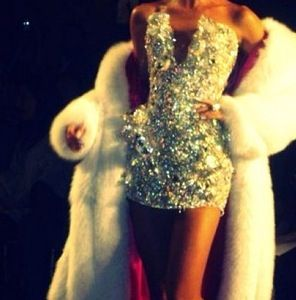 Sparkly dress. Beautiful white furr