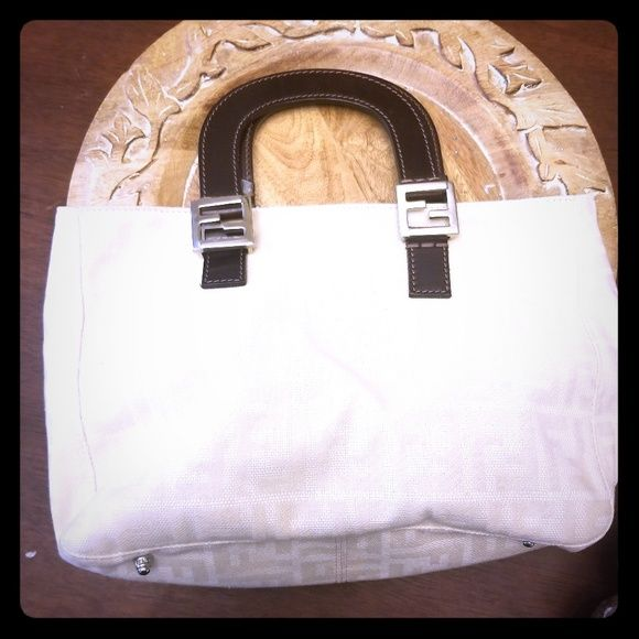 689fbdb133b6 Authentic Fendi Zucca Tote Canvas Cream and Tan Fendi monogram canvas tote.  Handle needs to be repaired