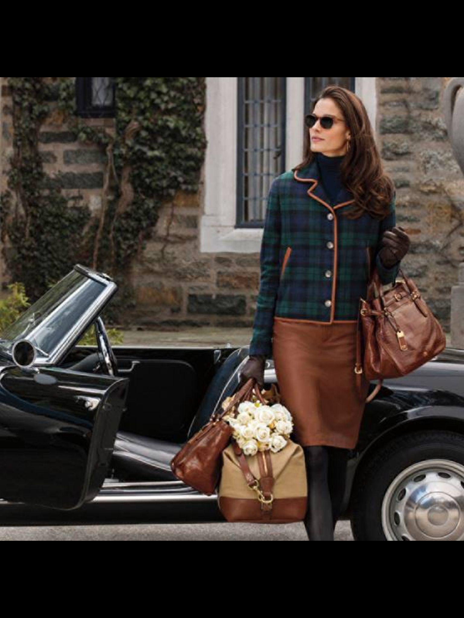 Blackwatch tartan jacket edged in a chestnut leather, paired with leather skirt. This is the definition of classy.