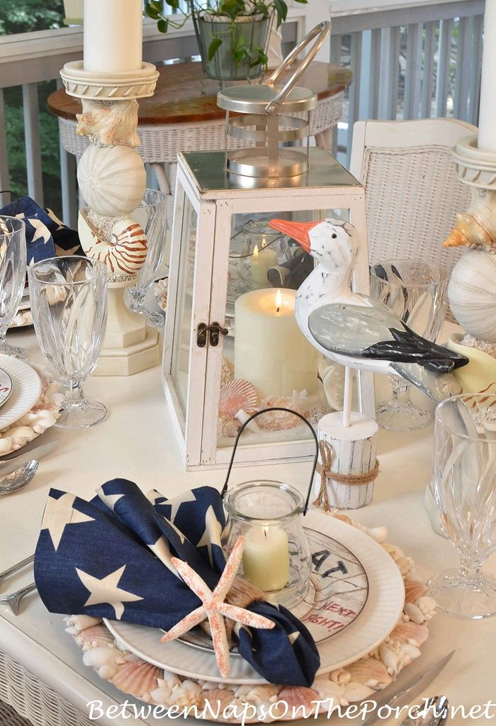 Nautical Tablescape With Shell Chargers And Fish Flatware Nautical Table Table Decorations Beach Table