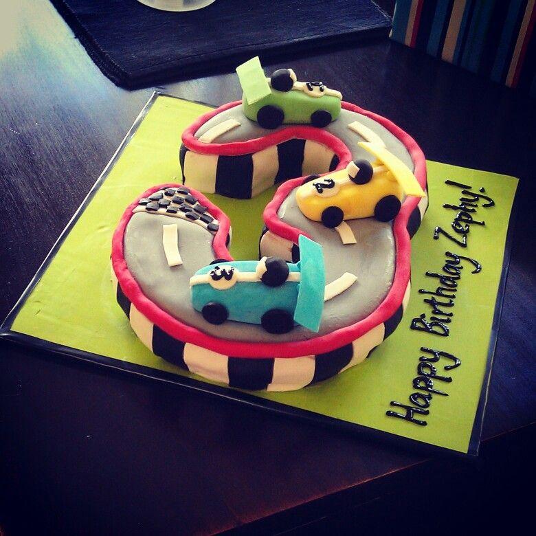 3 shaped race car cake