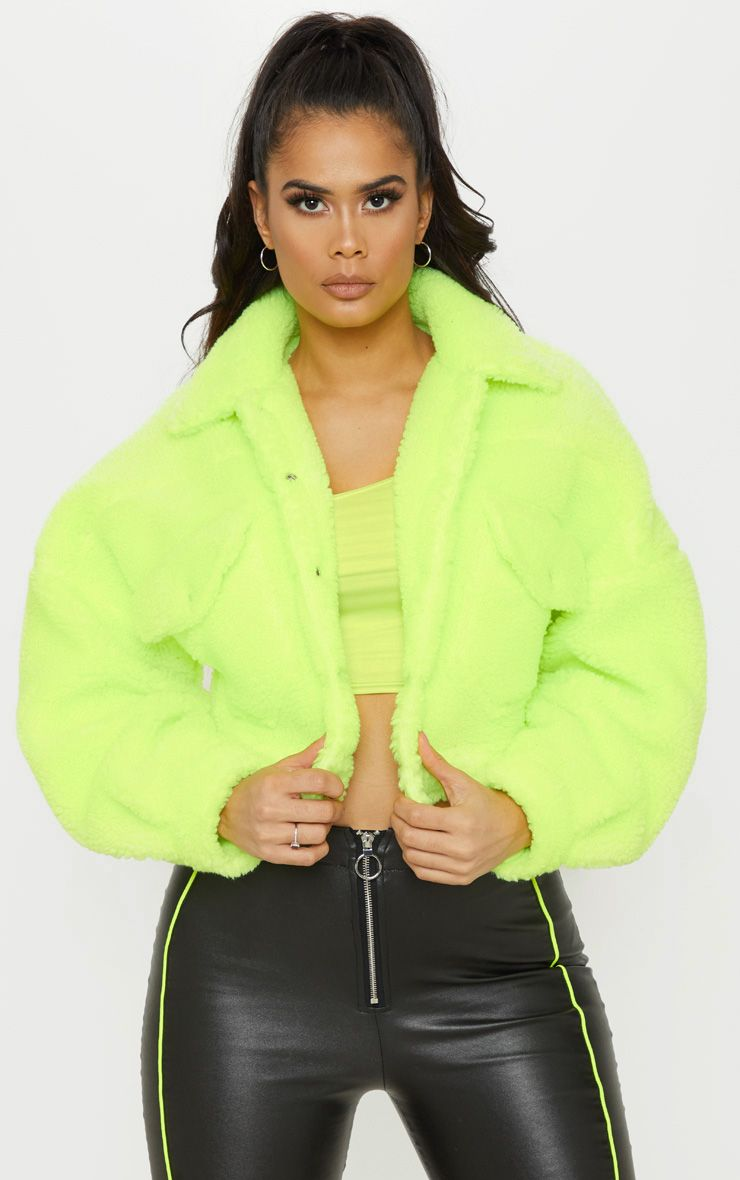 8dcfcc07ec1 Neon Green Borg Cropped Trucker Jacket This statement piece is a must-have  for those daring dolls.