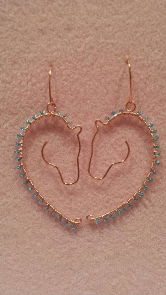 Photo of Items similar to Dangling show horse head earrings with a beaded mane. on Etsy