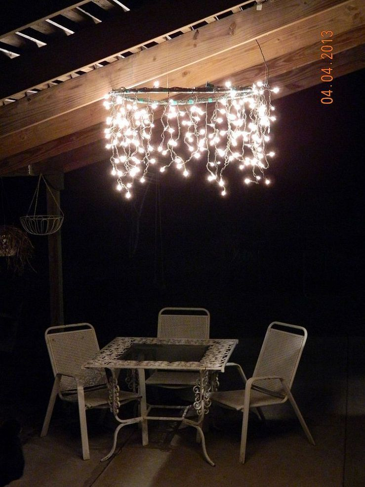 Hula hoop chandelier hula hoop spray paint 2 strands of icicle lights electrical tape and some heavy fishing line lighting idea for patio redeux