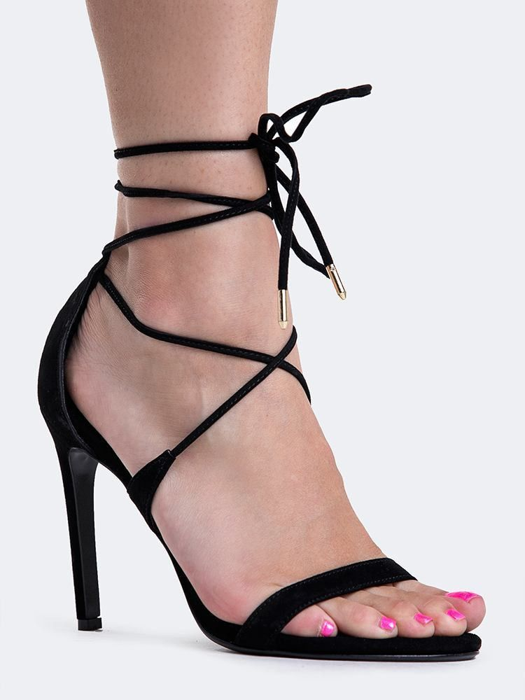 8ae5ae7ebbb Elongate your legs in these sexy lace up sandals! - Black heels crisscross  at the vamp and tie around the ankle making it the ultimate essential after  dark.