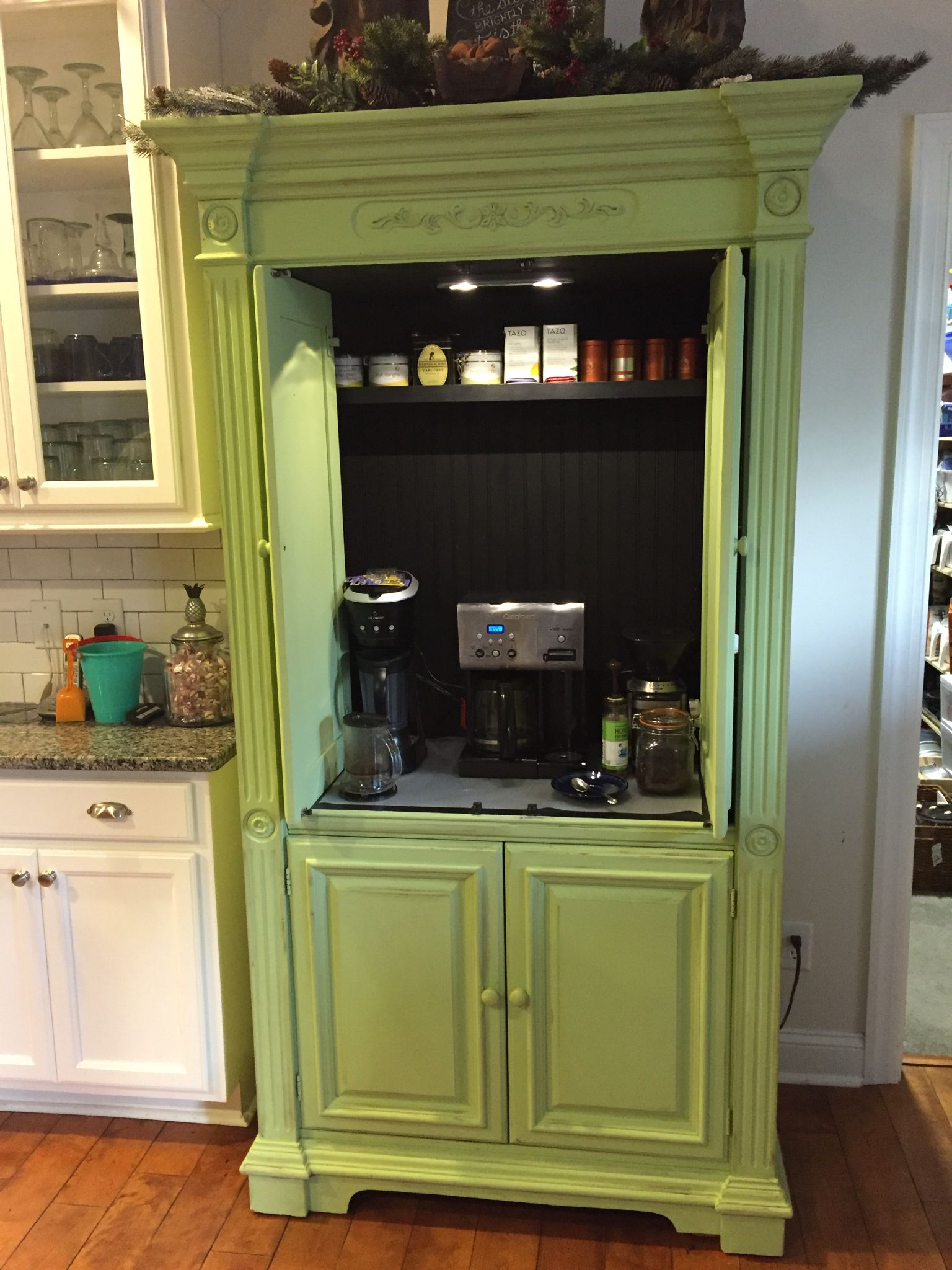 88d01351dfc4 Entertainment center painted and converted into a coffee and tea bar. Great  pop of green in a white kitchen.