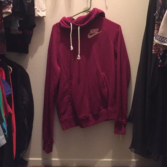 Nike Hoodie Super comfortable pinkish-burgundy Nike hoodie, lightly worn, has pockets on the side . Nike Jackets & Coats