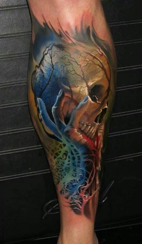 Hand Holding Up Skull Tattoo